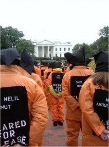 "Protesters in jumpsuits represent Guantanamo detainees ""Cleared for Release"""