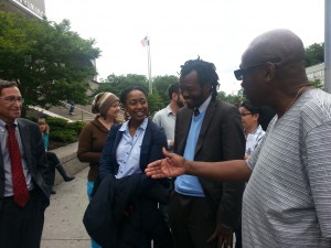 Discussing stop-and-frisk outside Queens Criminal Court.  Attorney Steve Silverblatt; defendant Ribka Getachew, and attorney Mani Taferi speaking with juror.